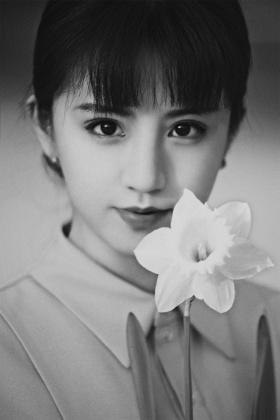She and daffodils